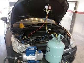 carga aire acondicionado auto taller mecánico