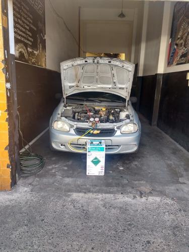 carga de aire acondicionado del automotor