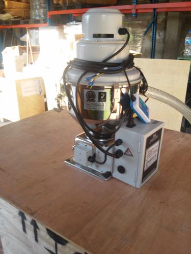 cargador para inyectora de plastico covimaq