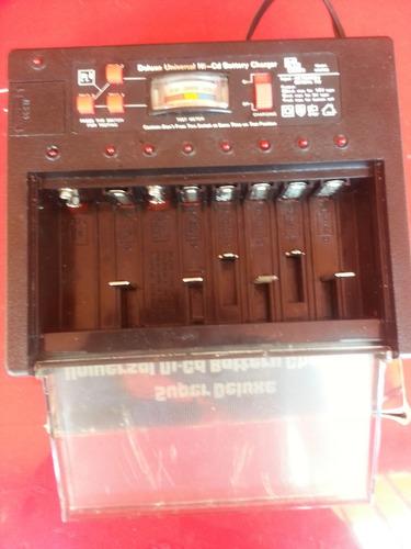 cargador universal deluxe todo tipo de baterias recargables