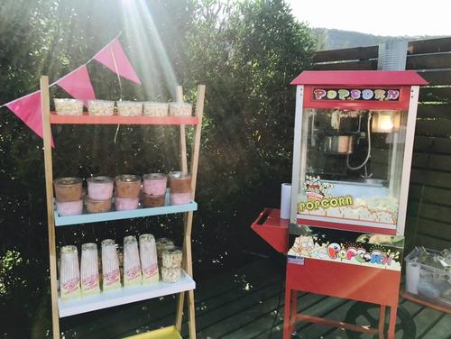 carro de cabritas y máquina de algodón de azúcar