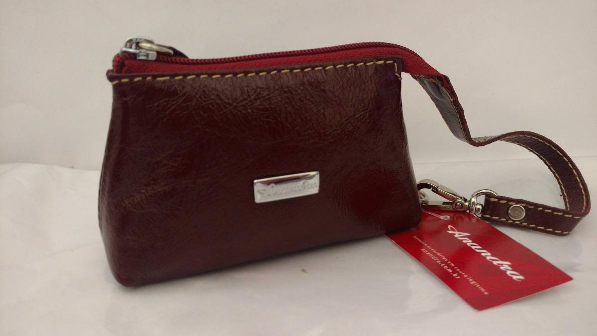 b158df1204 carteira em couro anandra porta níquel na cor cereja. Carregando zoom.