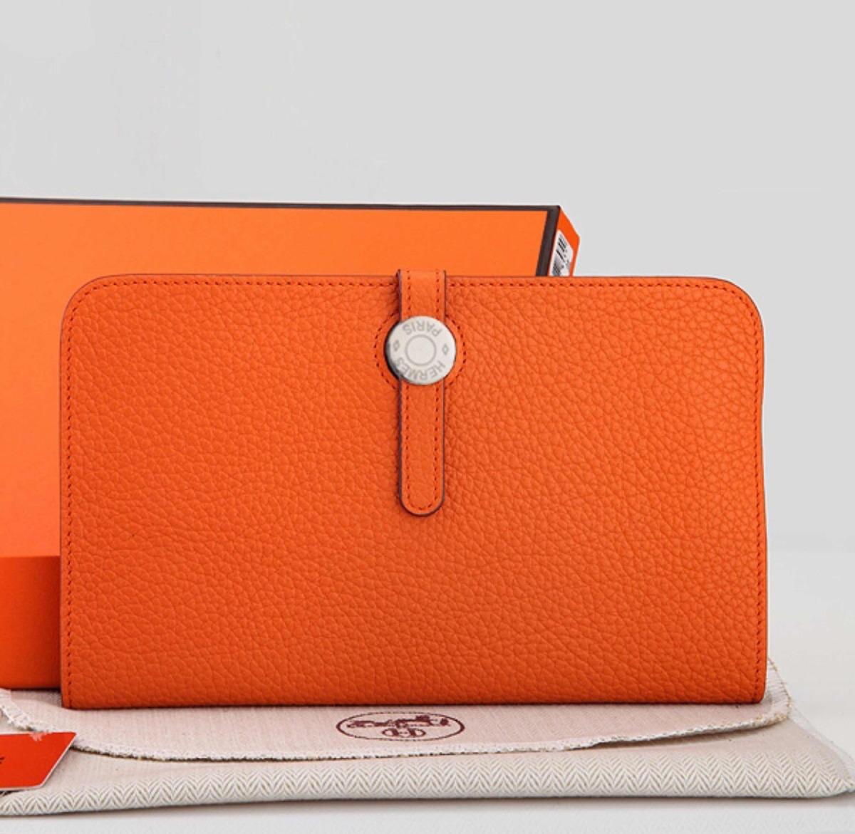 5ed29b23b6c carteira hermes de couro laranja. Carregando zoom.