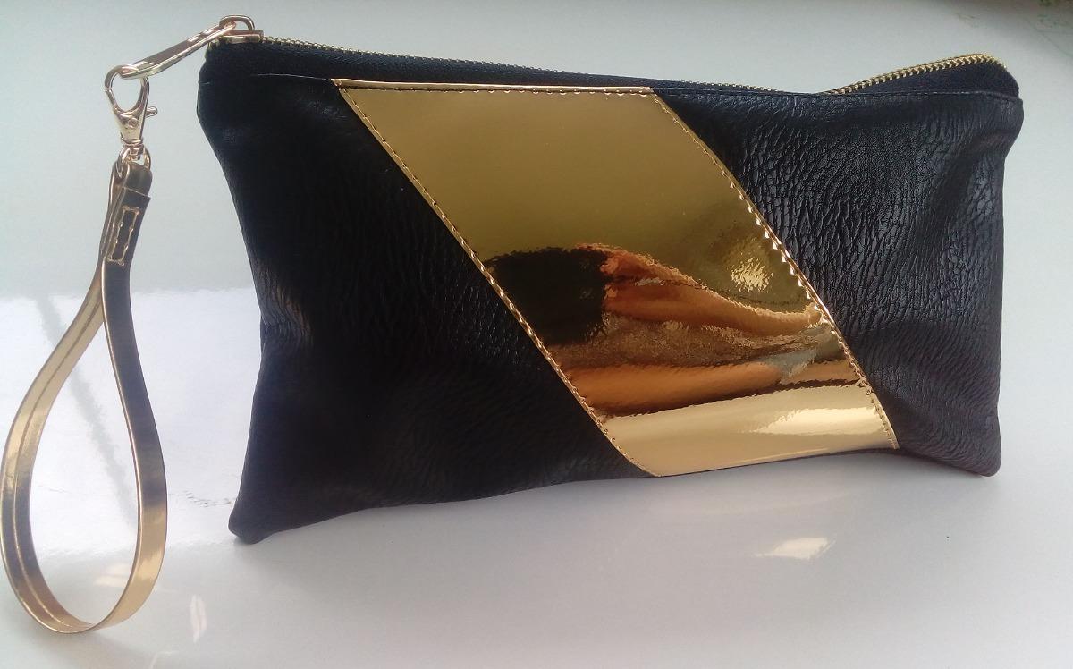 bd876928d85 cartera bolso de mano tipo sobre clutch dorado negro. Cargando zoom.