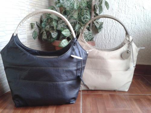 carteras, bolsos, baúles, bandoleros y algo mas para damas.