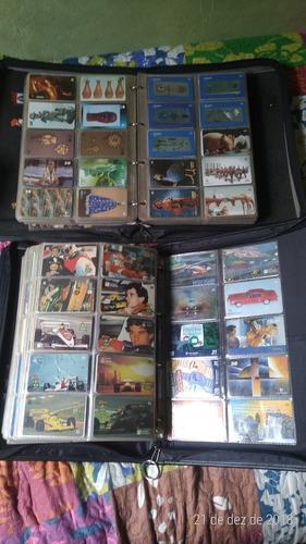 cartões telefônico coleção 2866 + fichário e os plástico.