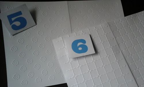 cartulina con textura blanca o color. medida 14,5 x 23 cm