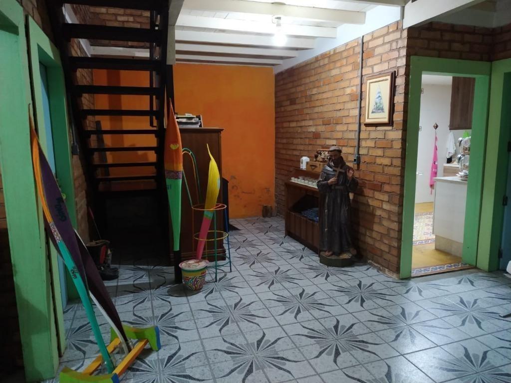 casa com 4 dormitórios e acesso privativo ao mar à venda, por r$ 1.485.000 - centro - são josé/sc - ca2334