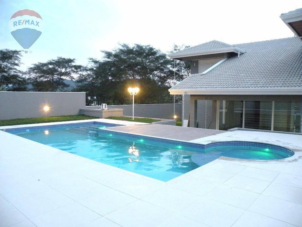 casa com 4 dormitórios à venda, 383 m² por r$ 1.950.000 - condominio porto atibaia - atibaia/sp - ca5243