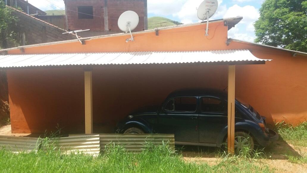 casa com dois quartos cozinha banheiro 2 varandas e garagem
