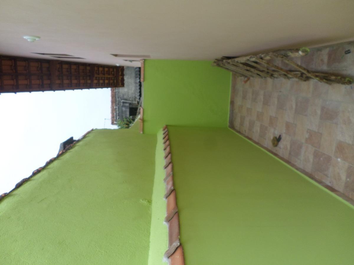 casa com garagem para 2 carros em itanhaém.