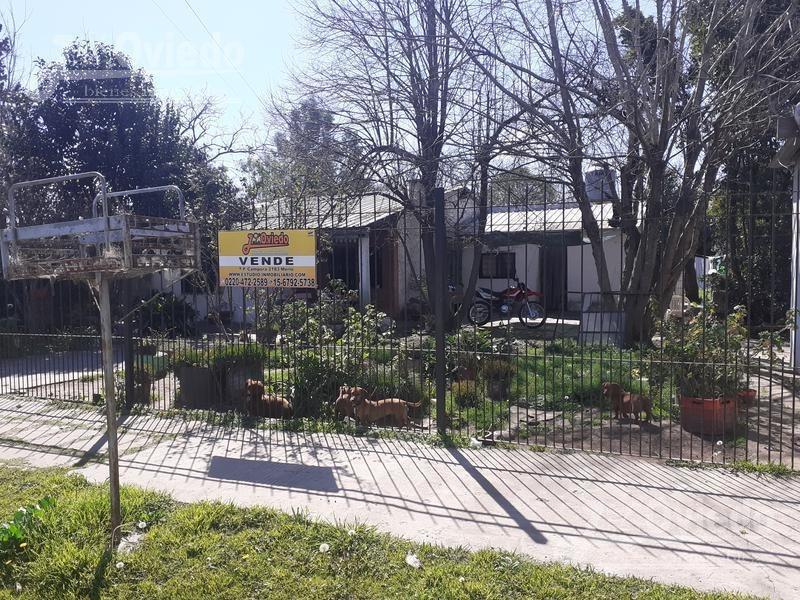 casa con escritura en merlo y amplio patio**