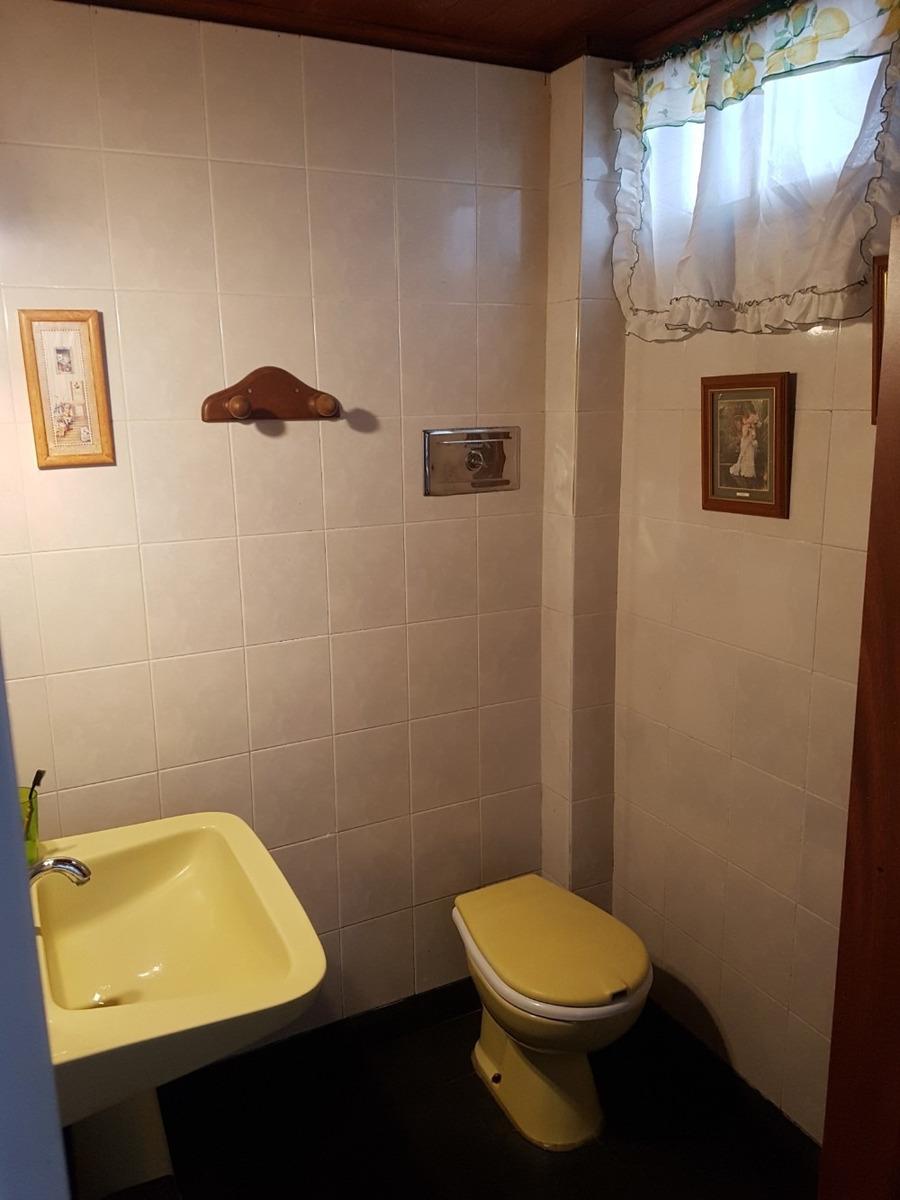 casa con local  (en venta)