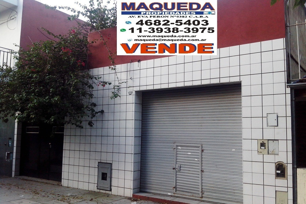 casa con local y quincho entrada 5 autos  lote 24 mts