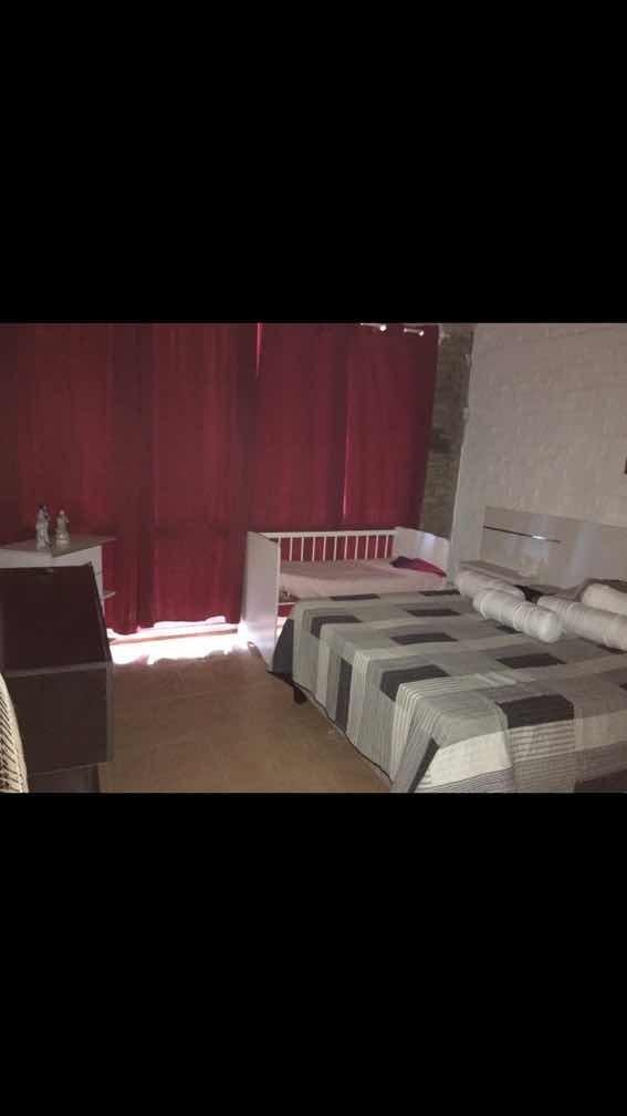 casa con títulos de propiedad  2 cuartos baño,living,cocina