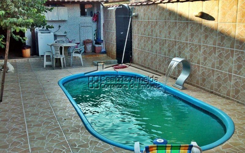 casa de 2 quartos, sendo 1 suíte, com área de lazer com piscina