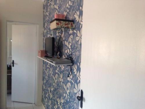 casa de praia,com 2 dormitórios,com uma churrasqueira !!!
