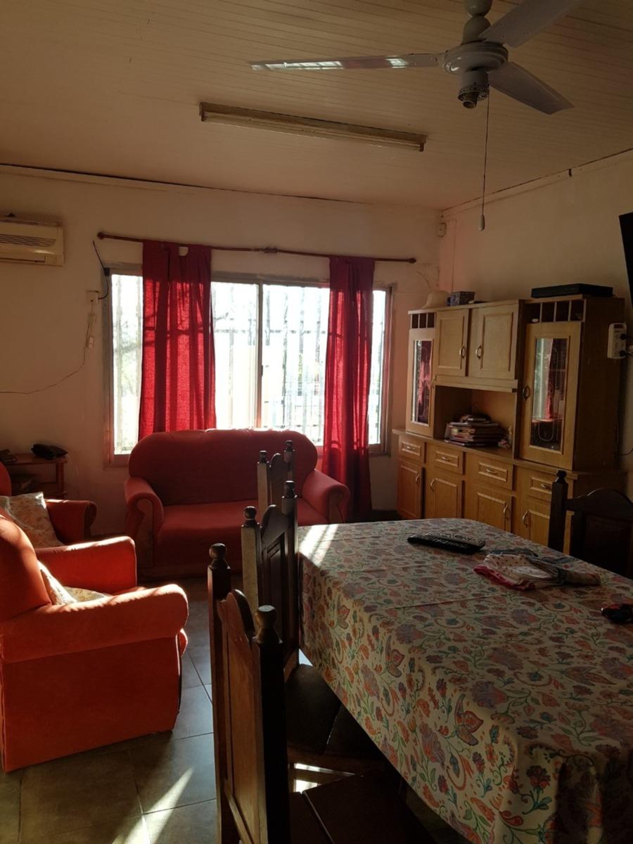 casa de tres dormitorios