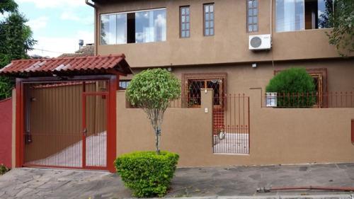 casa em cavalhada com 4 dormitórios - lu5752
