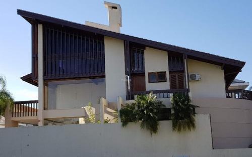 casa em jurerê internacional com 4 suítes, 4 vagas e piscina