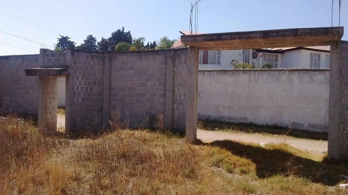 casa en obra negra y terreno