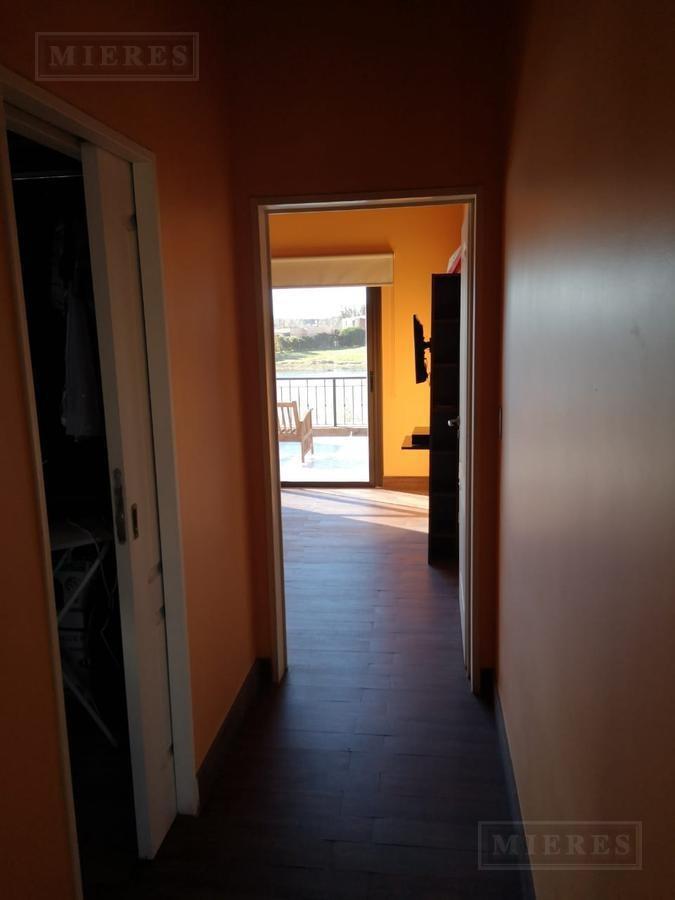 casa en venta con salida a la laguna  barrio cerrado san marco