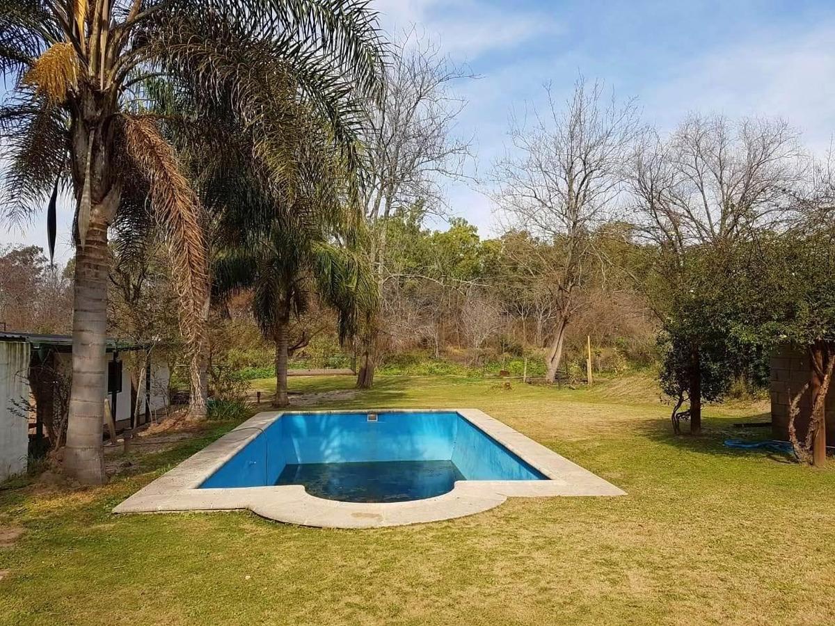 casa en venta con salida al rio carcaraña, oliveros, santa fe.