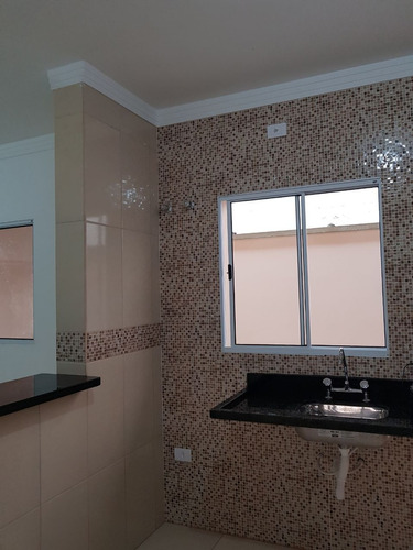 casa geminada à venda a 400 metros da praia em itanhaém. 399