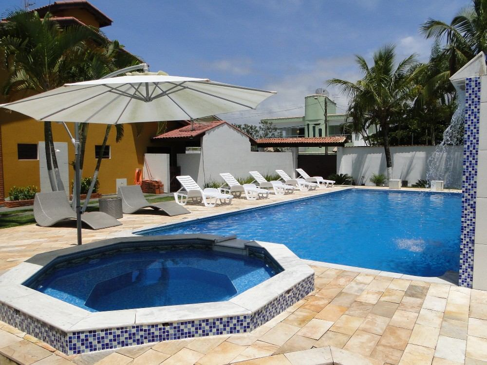 Casa na praia com piscina aquecida 2spar ofuro sauna ar for Piscina in casa