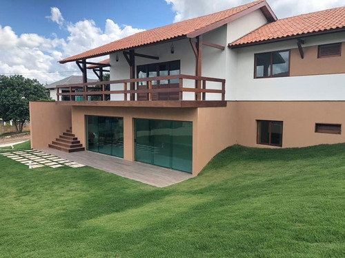 casa nova com 5 suítes, terreno com 1.000 mts em condomínio