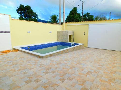 casa nova com piscina em peruíbe disponível para venda.