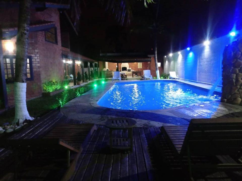 casa praia alugar temporada litoral piscina aquecida 36°