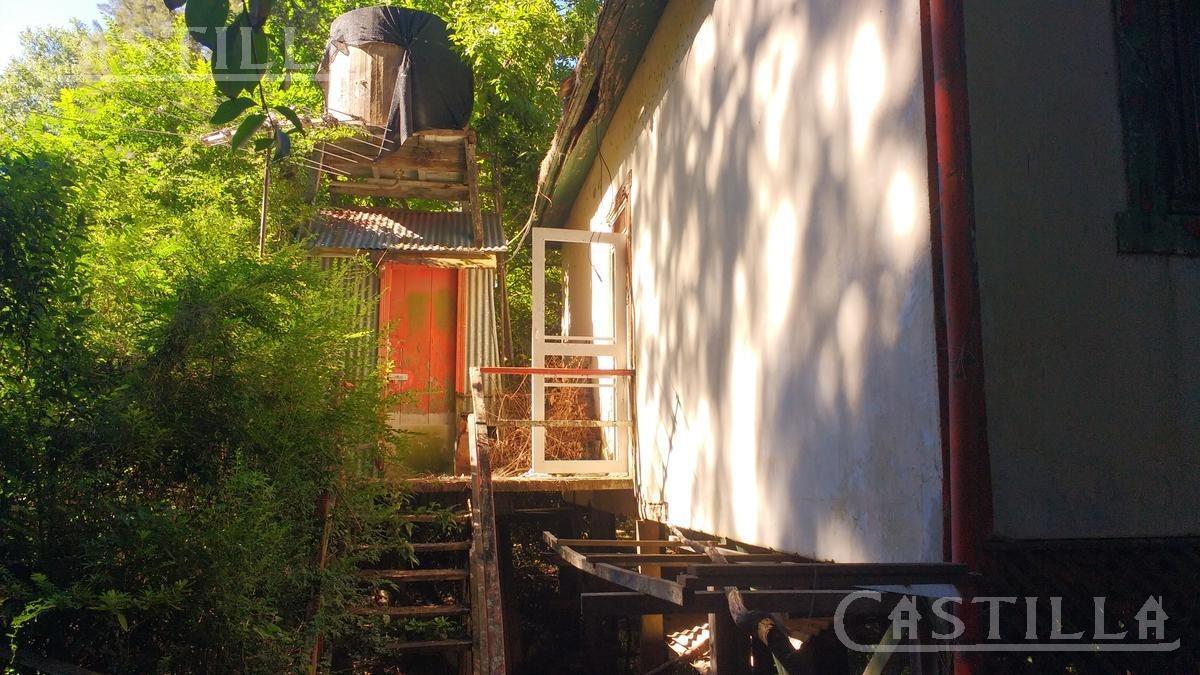 casa sobre lote de 80 metros de frente sobre el rio capitan