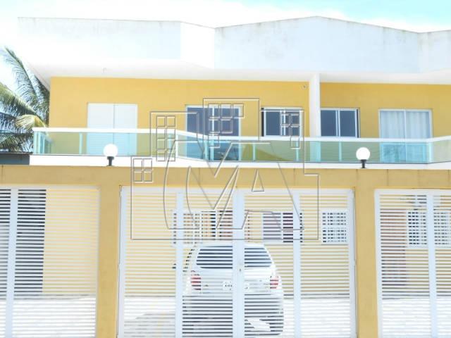 casa sobreposta alta em praia grande , 2 dormitórios , nunca habitada , próxima ao terminal de ônibus e ao comercio ,aceita financiamento bancário