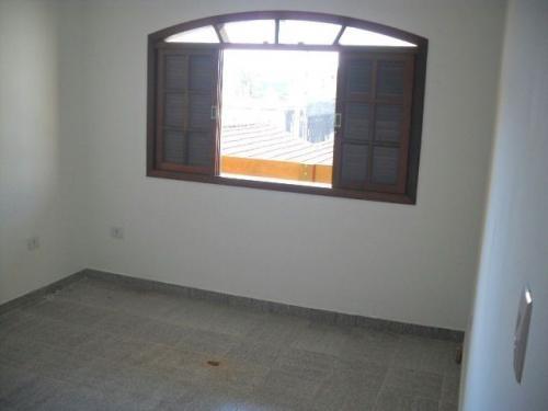 casa sobreposta em itanhaém com 2 dormitórios