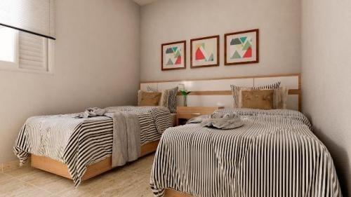 casa sobreposta lado praia em itanhaém, com 2 dormitórios