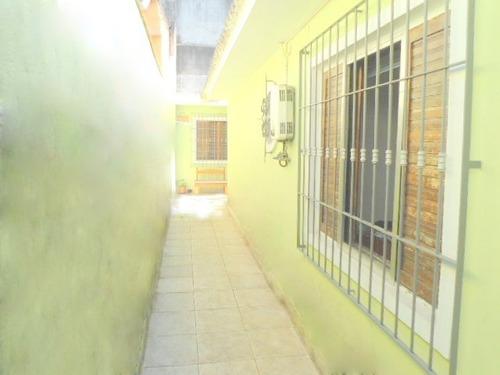 casa térrea 2 vagas, quintal, churras. no jd. ester ref fl23