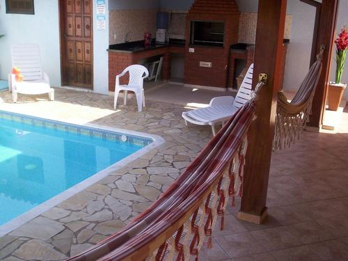 casa térrea,em condomínio fechado de frente para a praia.