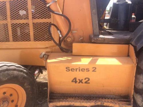 case 580 l serie 2 con martillo daemo