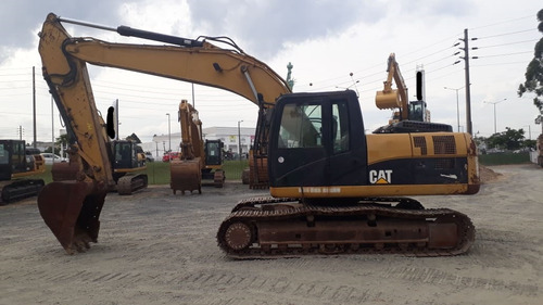caterpillar 320dl ano 2010  8.600hs