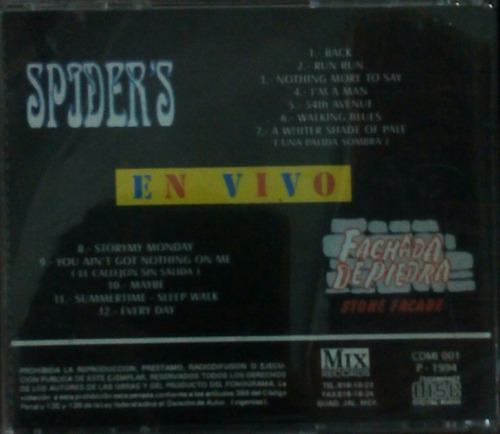 cd spiders en vivo fachada de piedra