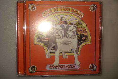 cd status quo dog of two head usado