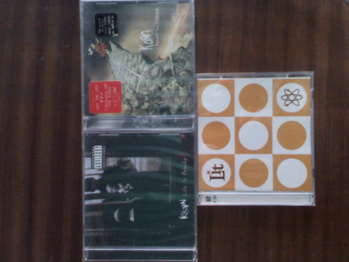 cds de korn y el grupo lit