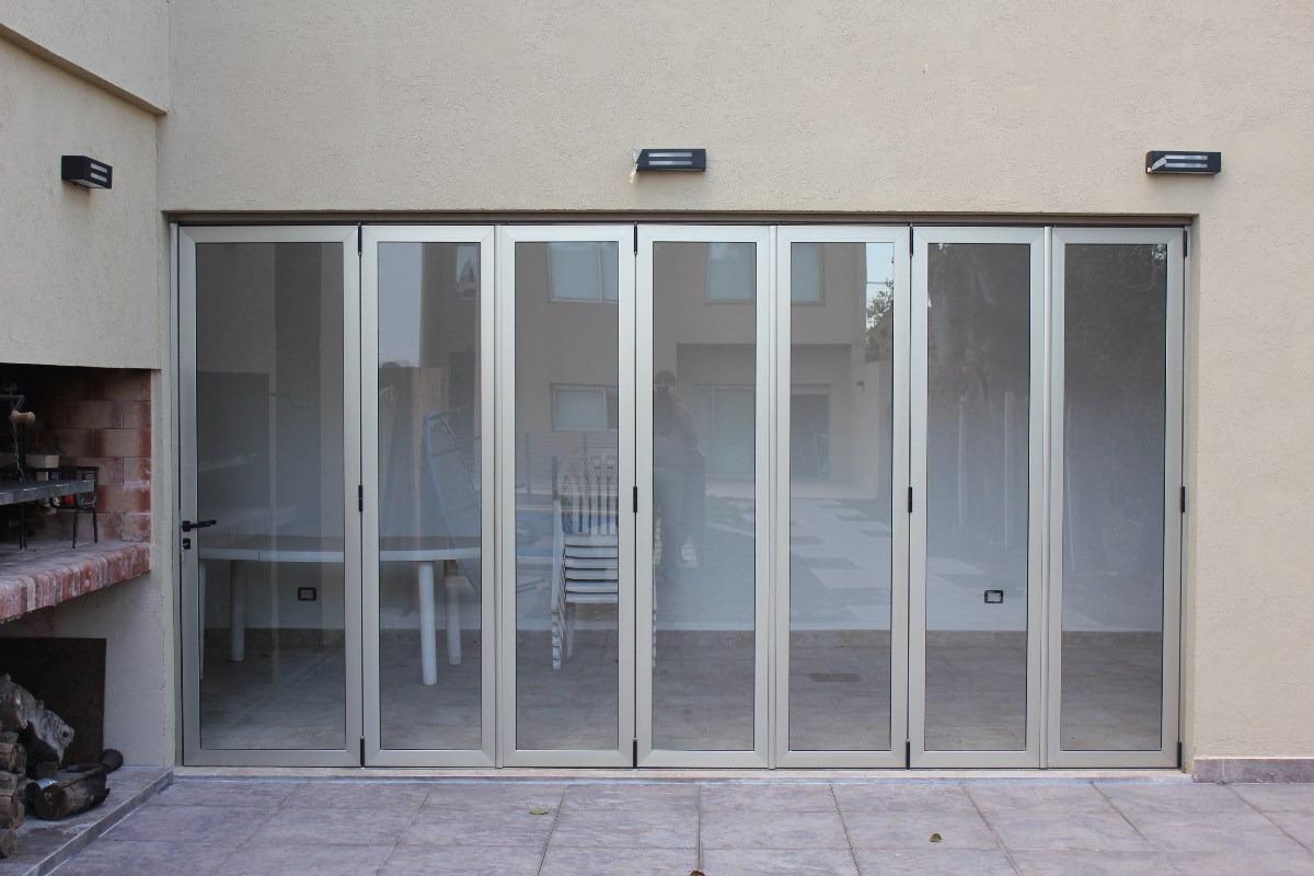 Cerramientos en aluminio y vidrio o policarbonato en for Puerta plegable aluminio