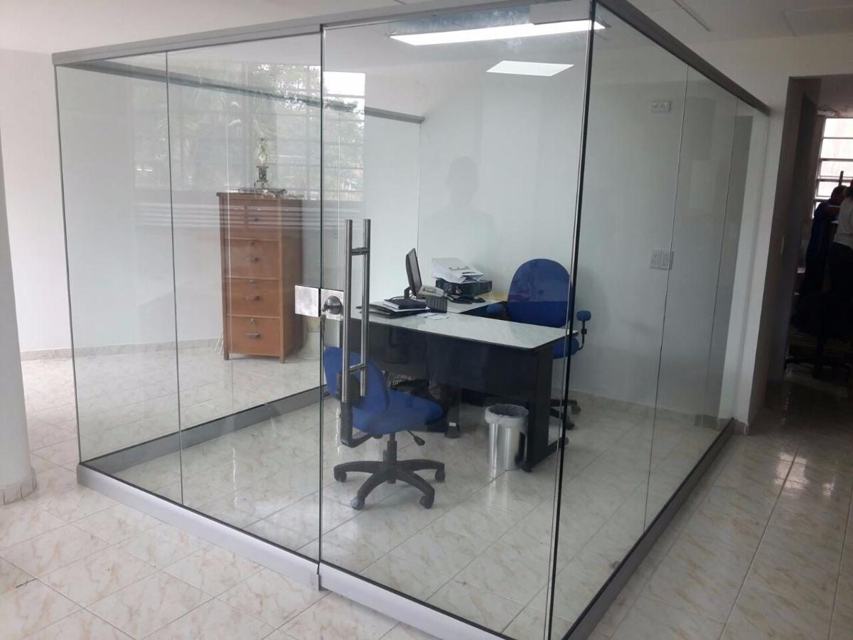 Cerramientos para locales y oficinas en cristal templado for Puertas de cristal para oficina
