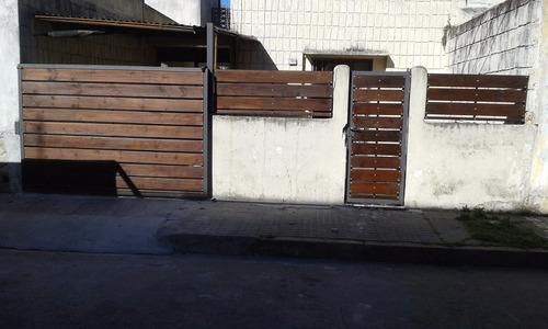 cerramientos perimetrales  hierro y madera