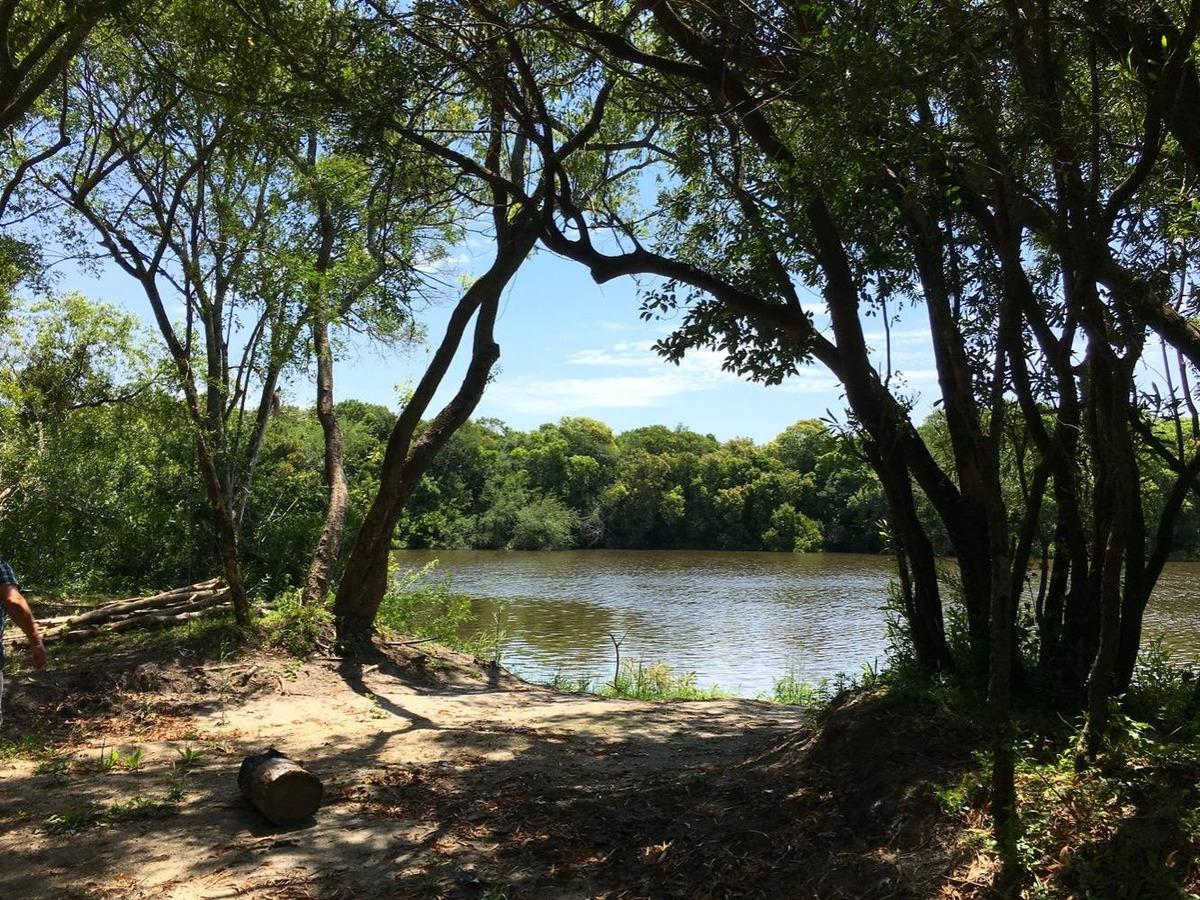 chacra con costa al río rosario