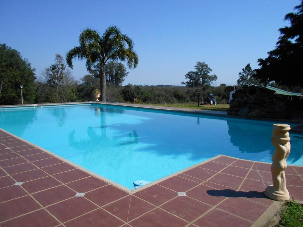 chacra con tres casas piscina caballeriza, galpón y olivos