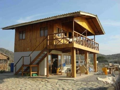 chalés madeiras  praia e serra. projetos e montagens.