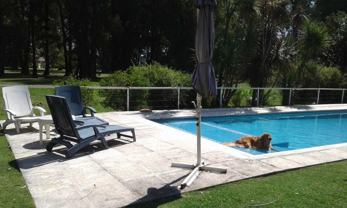 chalet 6 amb piscina climatizada lote 1500 m²  vista al golf